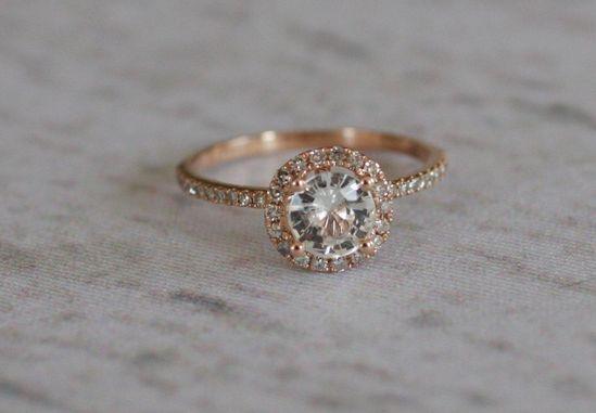 White sapphire diamond ring a 14k rose gold diamond setting. $1,100.00, via Etsy.