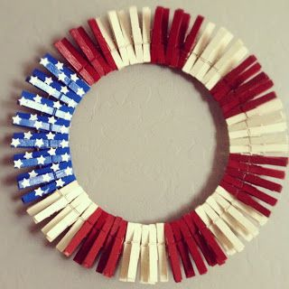 DIY Red, White & Blue Patriotic Wreath :: Materials: wire, wood clothes pins, red, white & blue paint, white stars stickers :: [1.] make the circle shape with the wire and set aside. [2.] Paint pins in 30 red, 30 white and 10 blue. Set aside to dry. [3.] Put dry painted pins on wire. Groups of 5 for white and red. 10 for blue. [4.] Place white star stickers on blue pins.