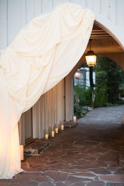 draped hallway leading to the reception