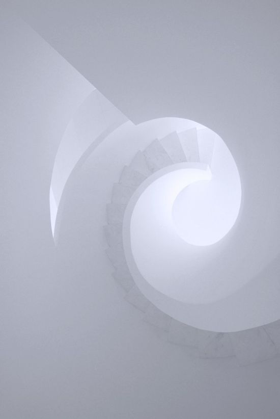 All-white spiral staircase inside the Lushi Hill Club in Beijing by Atelier Fronti.