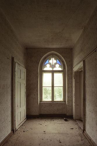 Gothic window in an abandoned mansion