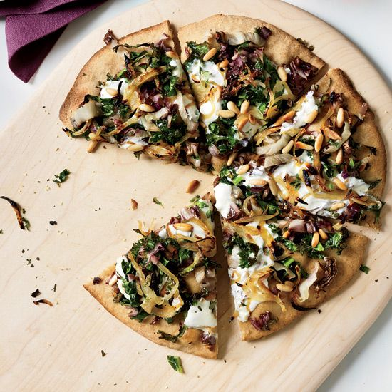 Whole Wheat Pizza with Onions and Bitter Greens // More Great Pizza Recipes: preview.foodandwi... #foodandwine