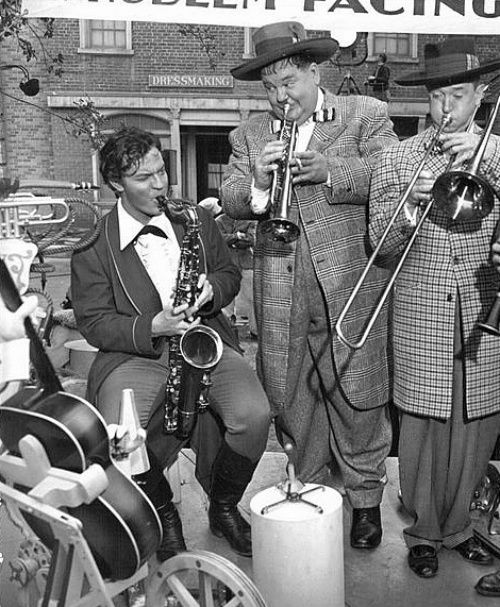 Orson Welles takes a break from filming to jam with Stan Laurel and Oliver Hardy on the 20th Century Fox lot, ca.1943