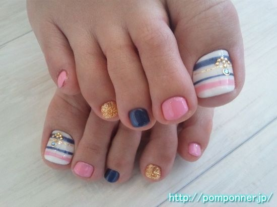 Super cute pedicure with stripes and solids! #mani #pedi #nails #manicure #pedicure #stripes #pink #blue #gold #glitter