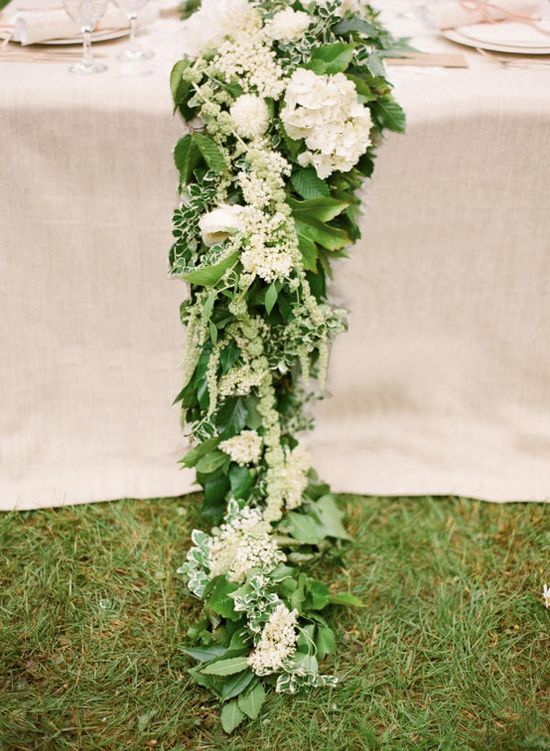 This garland can be made with orchids, and swagged off the front of the table, instead of down the middle.