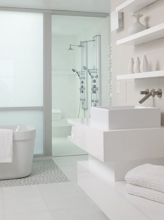 Loving all of the white in this #contemporary #bathroom #design
