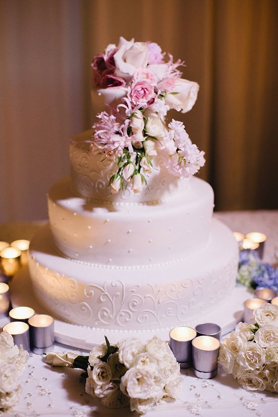 elegant white wedding cake with pink and purple flowers, photo by Elaine Palladino Photography