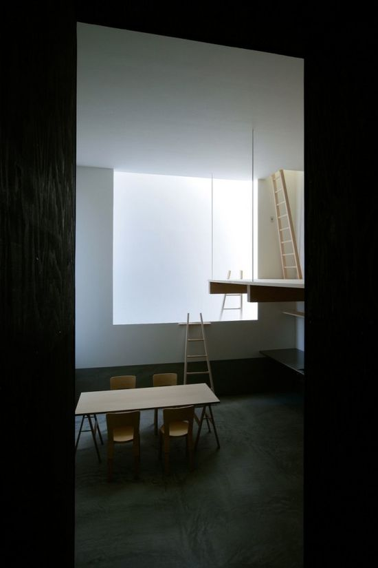 View of the livingroom with the rectangle of light inside this house by Japanese architect Jun Igarashi.