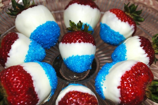 Strawberries dipped in white chocolate and then decorated in blue sprinkle sugar.. 4th of July appetizers