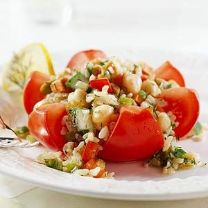 Stuffed Tomato Flower:  The filling of savory vegetables, salty olives, and sweet fruit transforms tomatoes into prizewinning edible flowers.