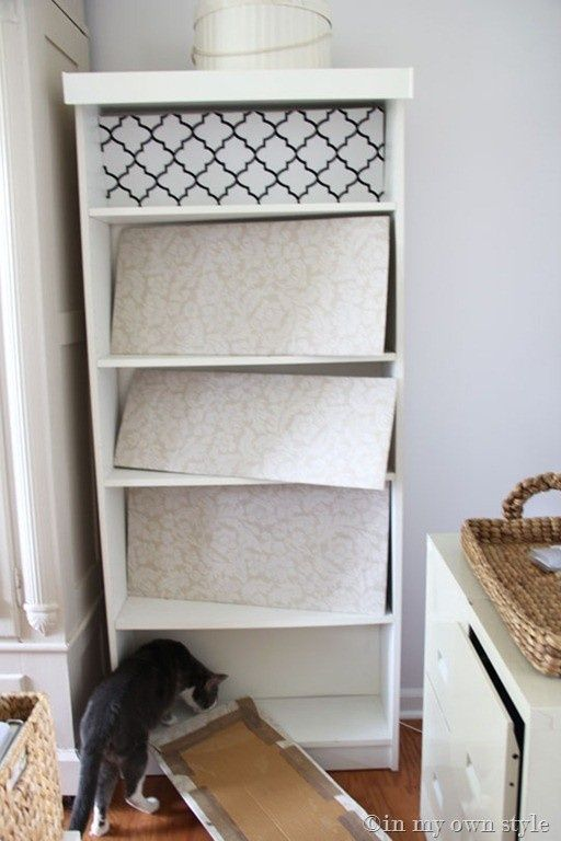 Cardboard   Fabric/wallpaper for Bookcase instead of paint! - great blog for DIY ideas