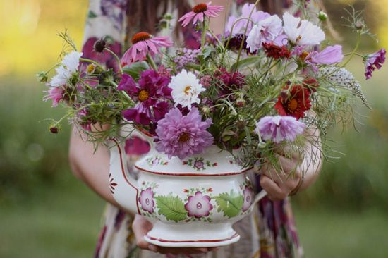 purple, white, and orange blooms thrown into an old teapot