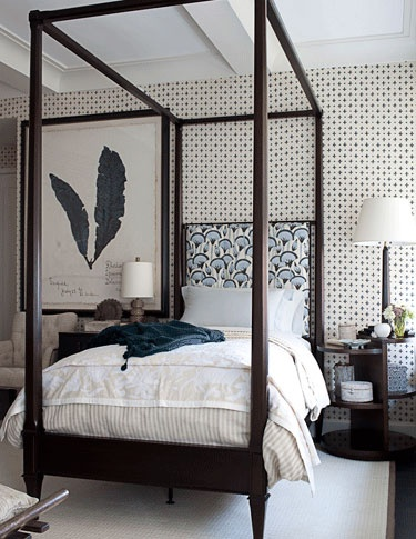 Mix of patterns on wallpaper, headboard fabric and overscaled artwork.