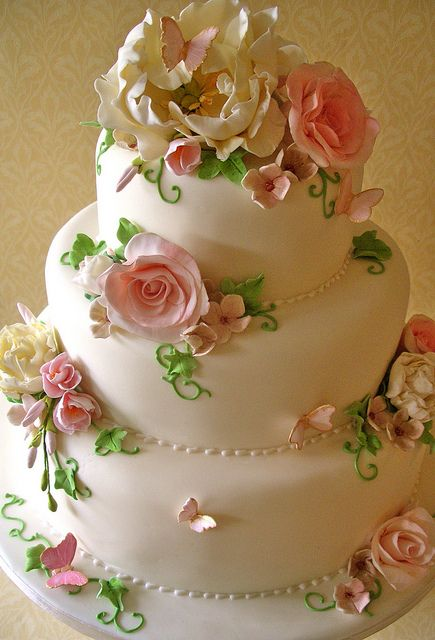 Pretty cake with flowers and butterflies.