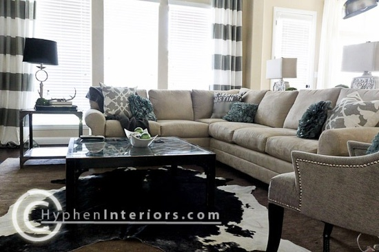 love the curtians, colors, cow hide over neutral rug.