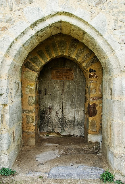 An ancient doorway gives access to a medieval French castle