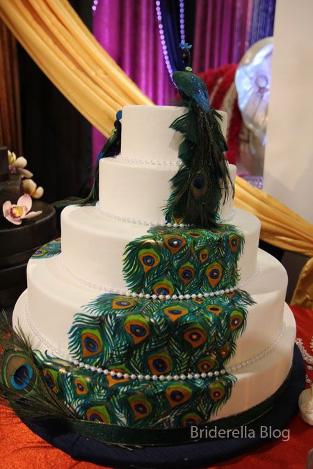 I love design on the cake... but not sure about the feathers on it.
