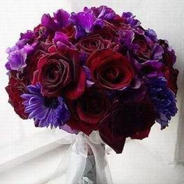 Gorgeous color combo flower floral arrangement of deep red roses and purple!! Love it!!