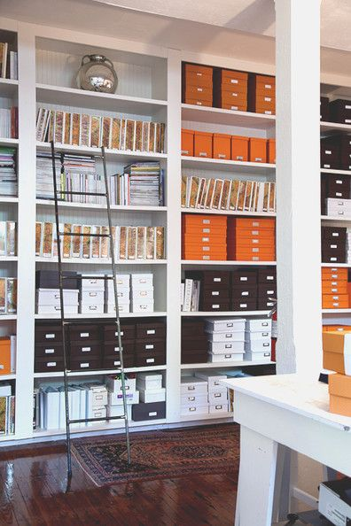 Floor to ceiling office shelves + orange bits and pieces for his office