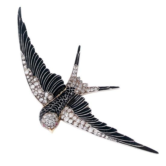 An Art Nouveau Enamel and Diamond Bird brooch. UK, circa 1900.