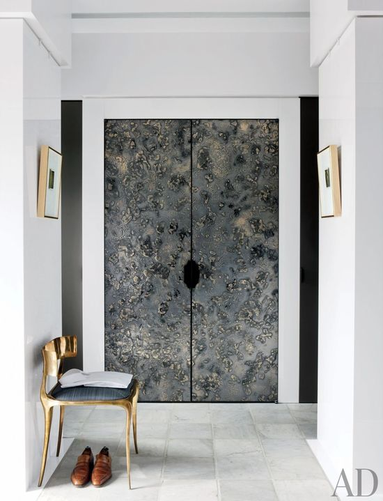 A dressing area features resin-and-metal doors crafted by Based Upon and a chair is by Paul Mathieu.