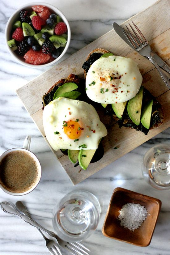 Olive Oil Poached Eggs on Avocado and Braised Kale Toast by thedeliciouslife #Eggs #Olive_Oil