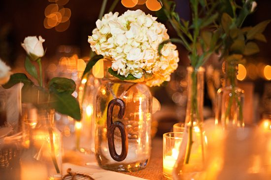 Table numbers as mason jars with flower arrangement