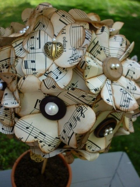 Flowers made from sheet music and buttons