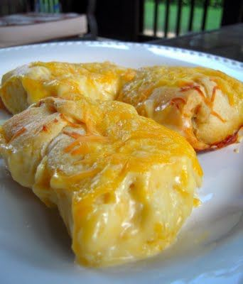 This looks delicious! 350 for 30 mins - crescent rolls, cream cheese, chicken, shredded cheese, cream of chicken soup, butter, seasoning salt, milk.