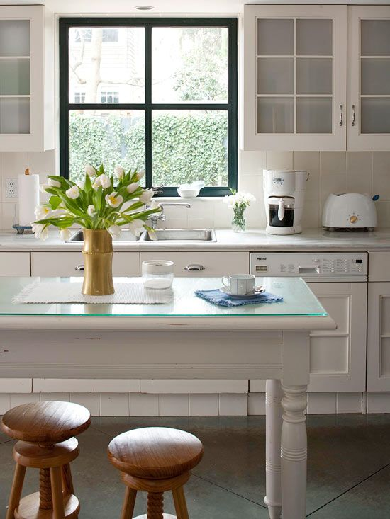 white kitchen, painted window frame, table island