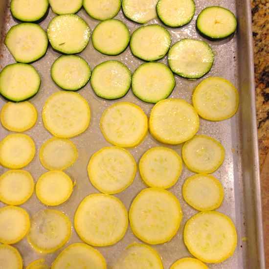 add a little parmesan cheese just before they are done, you will also have to make two pan's one is just not enough because they are so good!!  Squash Chips 375 degrees for about 30 min and enjoy the best snack ever