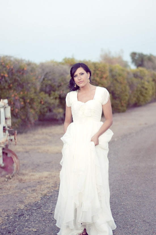 a beautiful sleeved dress by allurebridals.com...  Photography by chantelmarie.com