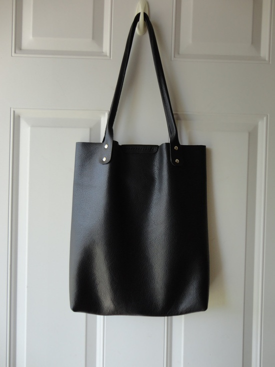 The perfect simple leather tote. black leather tote. $80.00, via Etsy.