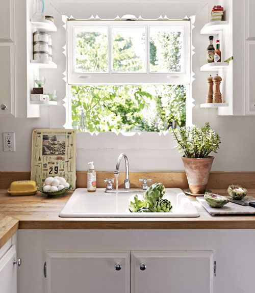 Butcher-block counters and original hand-carved scrollwork surrounding the window leave a lasting impression.