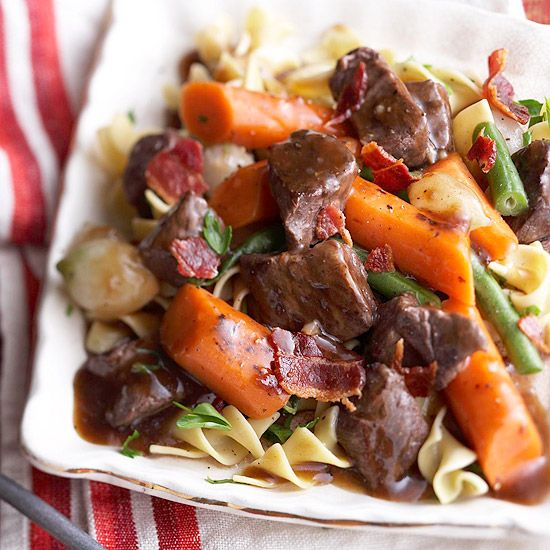 Slow Cooker Burgundy Beef Stew - tender beef and veggies are simmered in a red wine-beef broth mixture and served over egg noodles for a delicious meal. #CrockPot #SlowCooker #Beef #Stew #Recipes