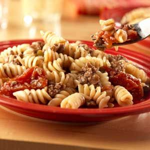 This one-skillet dinner combines seasoned ground beef, garlic, tomatoes and corkscrew pasta to make a quick and delicious dish that will save you on those crazy-busy nights.