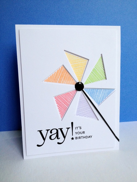 handmade birthday card ... clean and bright ... careful placement of triangle die cuts makes a negative space pin wheel ... spaces backed in lovely pastels ... fun sentiment ...