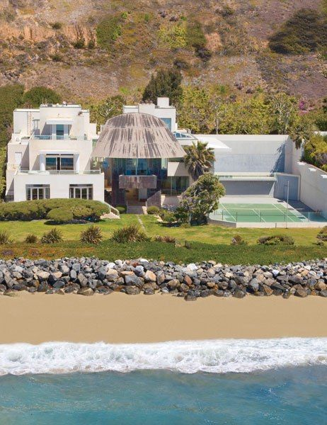 STATS  6 BEDROOMS  10 BATHS  11,400 SQ. FT.  $57.5 MILLIONPEDIGREE: This 1989 oceanfront home was conceived by Frank Gehry for insurance executive Burton Borman. Its striking concrete portico acts as a curvaceous centerpiece to the otherwise hard-edged structure. The free-flowing layout facilitates movement between the indoor and outdoor living spaces, while expansive windows welcome the abundant light and provide stunning sea views.