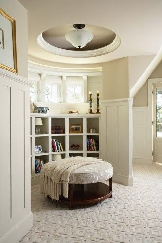 A curved bookcase creates the perfect nook in a master bedroom.  Interior design by the Billy Beson Company.