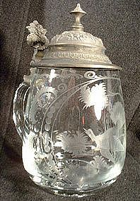 19th century antique Bohemian Cut Glass Beer Stein. The cut glass picture shows a bird in a tree. Make sure this precious find is protected and visit: http://www.americancollectors.com/Collectible/17/.