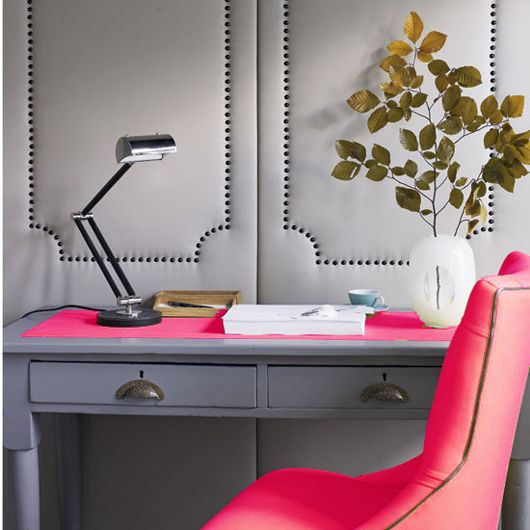 Gray + neon pink workspace. Check out the nailhead-trimmed wall!