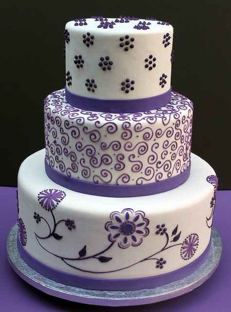 purple and white 3 tiered cake