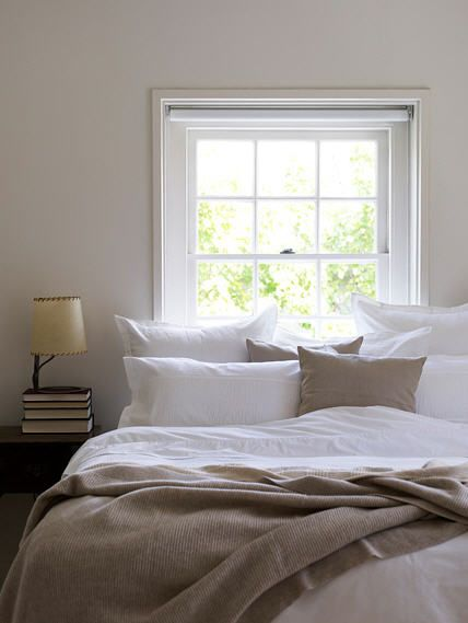 linen bedding and tan walls.