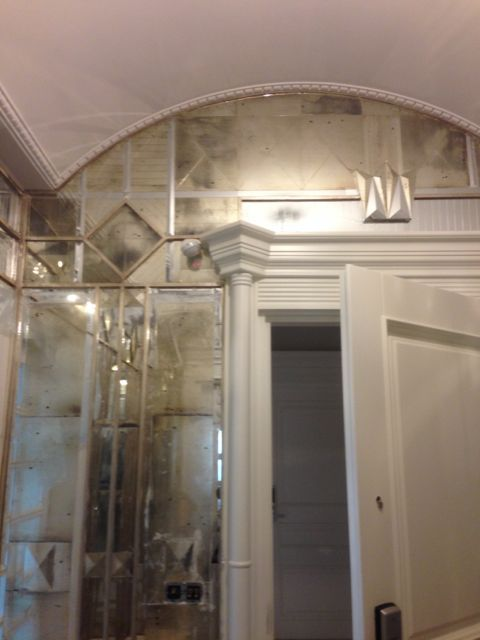 Mirror work design on the wall of foyer