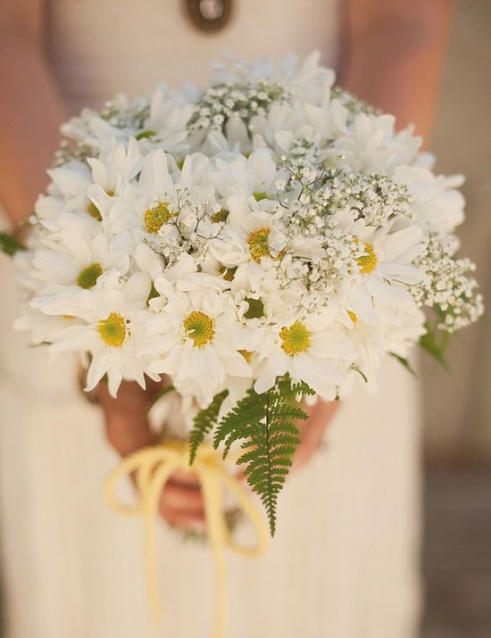 White daisies, baby's breath, and fern bouquet.