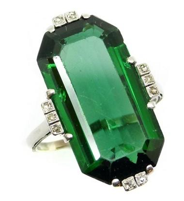Single stone green tourmaline and diamond dress ring