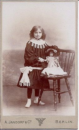 Young German girl with her doll, circa 1900.