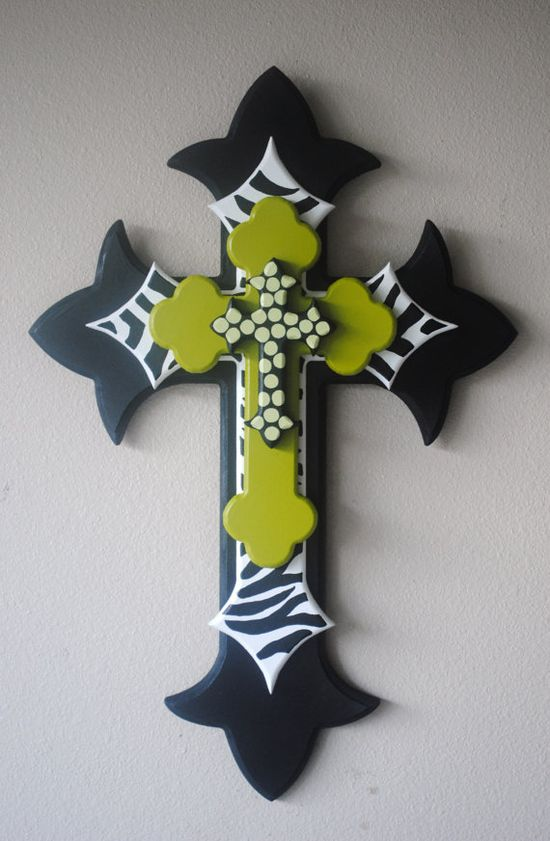 Buy different size crosses, paint them, then lay them biggest to smallest.  love this!