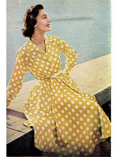 Such a sweet, cheerfully lovely 1950s yellow and white polka dot shirtwaist dress. #vintage #fashion #1950s