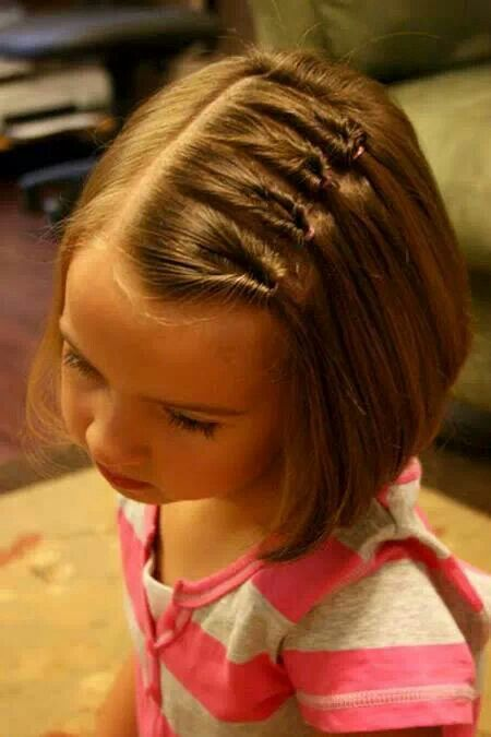 Easy girls hairstyle, no bows, straight hair and keeps it out of their face.
